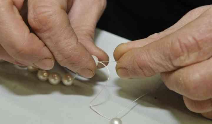 Fase di lavoro, infilat. perle