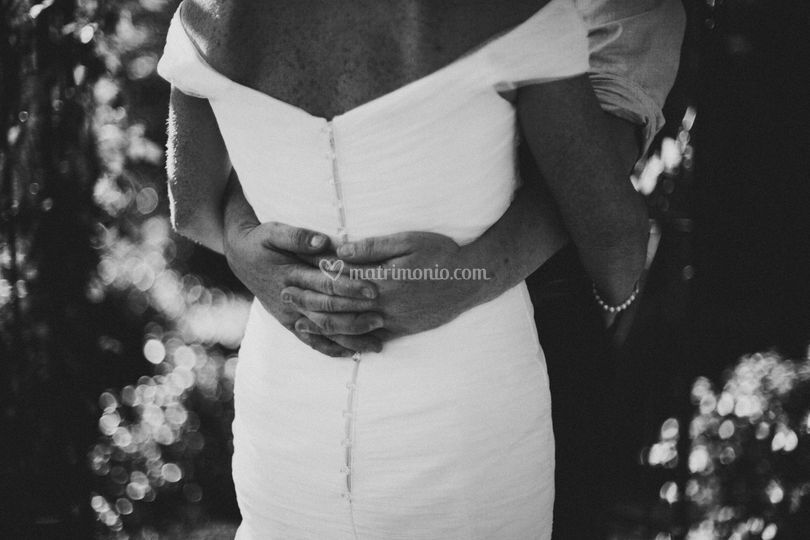 Embrace bride and groom