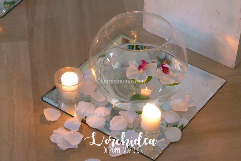Candele galleggianti di l orchidea foto