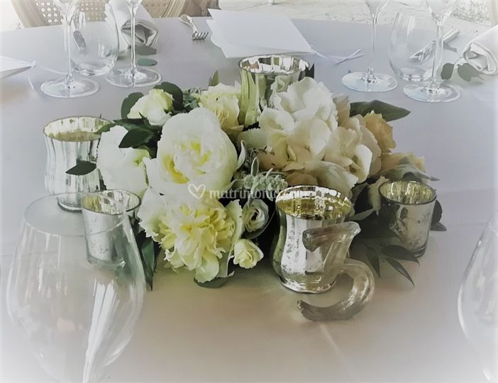 Centrotavola bianco e candele