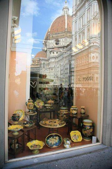 Vetrina A.Poggi con riflesso del Duomo