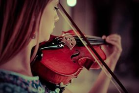 Thevriola Puqe Violinista