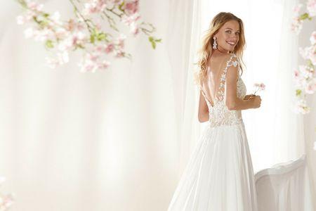 Sofisticata sensualità con gli abiti da sposa a schiena scoperta
