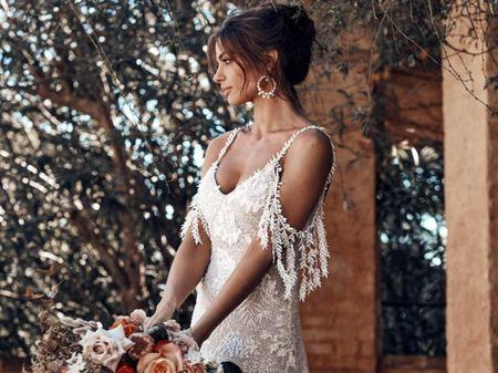 15 abiti da sposa con frange per un look nuziale glamour