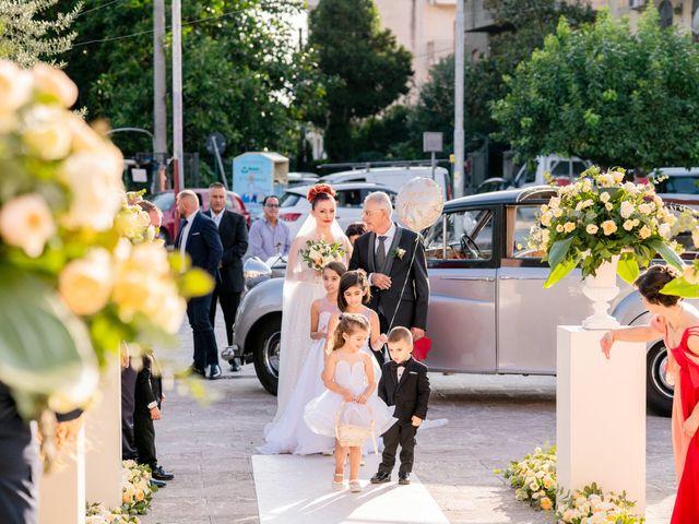 Il matrimonio di Rosaria e Orazio a Taormina, Messina 24