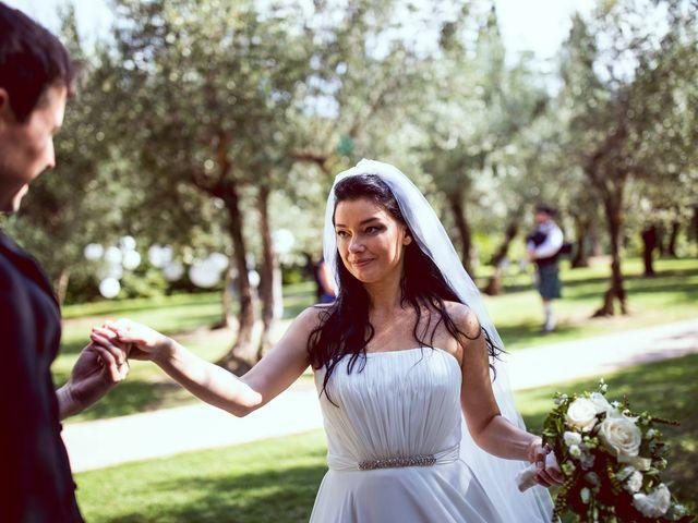 Il matrimonio di Scott e Ela a Sirmione, Brescia 34