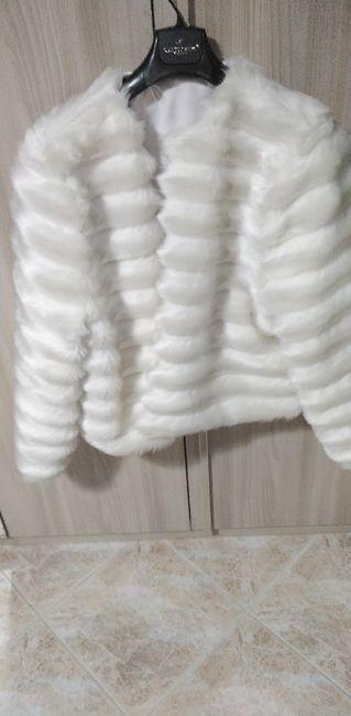 Sta bene questa pelliccia con il vestito? 1